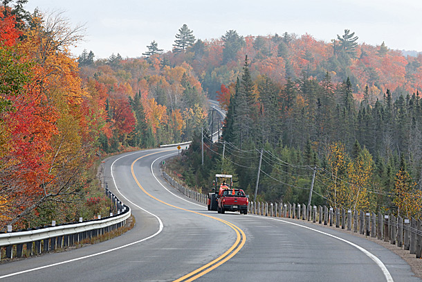 Approaching the West Gate of Algonquin Park on September 28, 2020. A road construction packer being escorted to a construction zone along Highway 60.